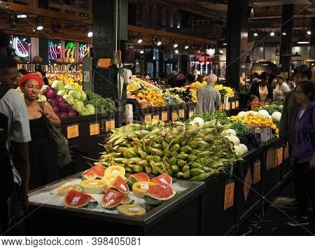 Philadelphia, Usa- June 11, 2019: Image Of People Shopping For Vegetables In The Reading Terminal Ma