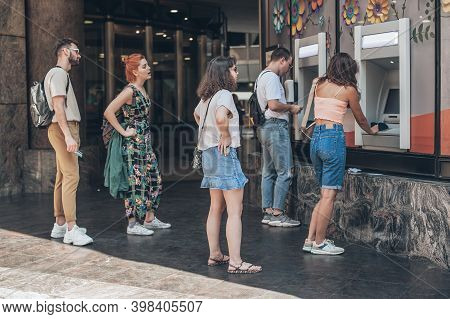 Line To Atm. Group Of People Waiting To Withdraw Money