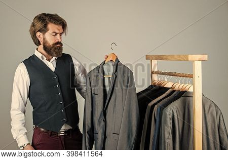 Fits Perfect. Man Clothing In Boutique. Man With Suit. Tailor In His Workshop. Handsome Bearded Fash