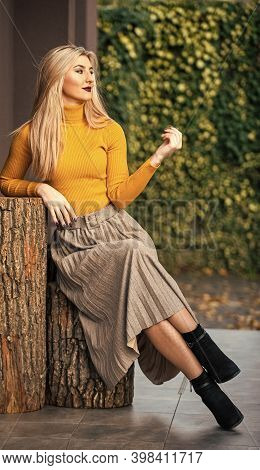 Fashion Is Her Life. Pleated Skirt Collection. Woman Warm Autumn Skirt Sit Outdoor. Relax While Walk