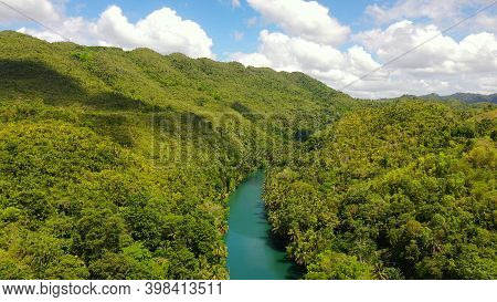River In The Rainforest In A Mountain Canyon. Loboc River In The Green Jungle. Bohol, Philippines.