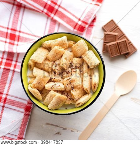 Crispy Corn Pads In A Clay Bowl With A Bottle Of Fresh Milk On A Light Background. Healthy Breakfast