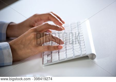 Close-up of businessman typing on the keyboard