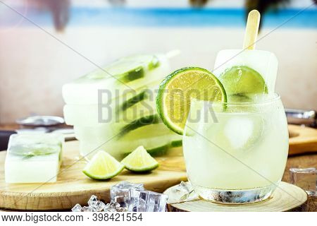 Glass Of Caipirinha With Lemon Popsicle, Typical Brazilian Cocktail Made With Lemon, Cachaça Or Pure