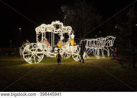 City Ogre, Latvia. Illuminated Golden Chariot And People.§