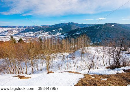Mountainous Countryside On A Sunny Day. Late Winter Scenery Or Beginning Of Spring. Melting Snow And