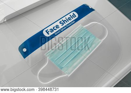 PPE face shield direct splash protection and surgical mask. Medical protective equipment for coronavirus prevention at stores and hospitals.