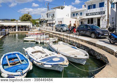 Paros, Greece - September 27, 2020: Coastal Promenade In Aliki Harbor. Aliki Is Beautiful Coastal Vi