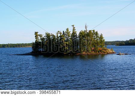 Tranquil Scenery At The Lake - Typical Canadian Landscape: Beautiful Lake And A Clear Blue Sky / Sio