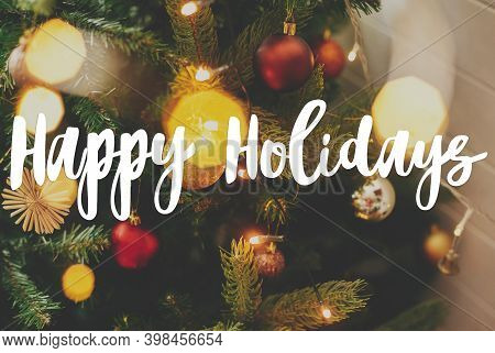 Happy Holidays Greeting Card. Happy Holidays Text Handwritten On Modern Decorated Christmas Tree Wit