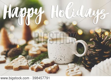 Happy Holidays Greeting Card. Happy Holidays Text Handwritten On Christmas Gingerbread Cookies, Coff