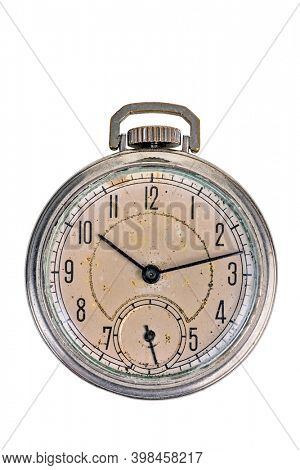 Antique corroded and dirty pocket watch isolated on white background