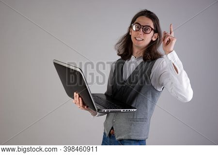 Programming And Writing Code, Developing Software Products. Geek Guy, With Long Hair And Glasses, Ho