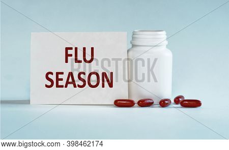 Flu Season Medical Concept. Text On White Paper Flu Season Of Flu On A Blue Background Next To A Whi