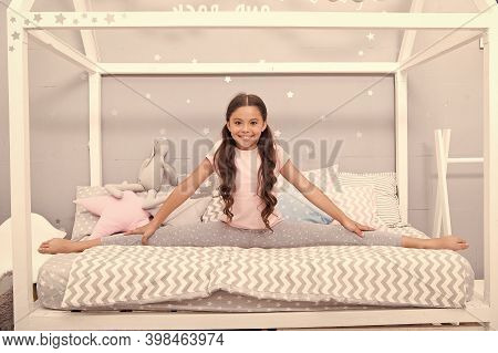 Being Fit And Flexible. Athletic Girl Do Leg Split On Bed. Fitness And Exercising. Developing Physic