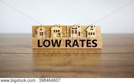 Low Rates Symbol. Wooden Blocks Form The Words 'low Rates', Miniature Houses, Wooden Table. Beautifu