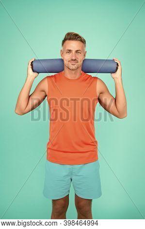 Be Training Inspiration. Fit Man Hold Yoga Mat Blue Background. Yoga Training. Physical Training Act