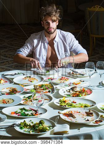 Sexy Man At Restaurant. Diet Guy, Choice Between Healthy And Unhealthy Food. Male With Food Deliciou