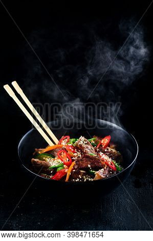 Stir Fry Soba Noodles With Beef And Vegetables In Wok On Dark Background, Asian Udon Noodles With Be