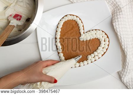 Step-by-step Heart-shaped Cake Recipe Instructions. Step 10: Apply The Cream To The Cakes With A Pas
