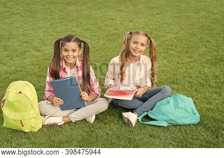 Knowledge Day Came. Having Fun On Green Grass. Two Little Kids With Backpack. Small Girl Play And St