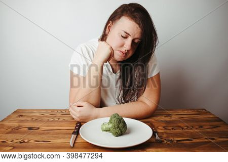 Dieting Problems, Eating Disorder. Sad Overweight Woman Dealing With Anorexia Or Bulimia Sitting At