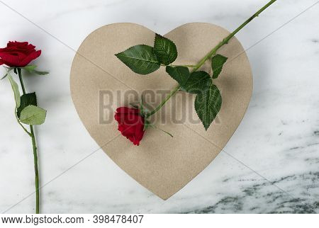 A Large Cardboard Heart Giftbox With Red Roses For Happy Valentines Day On A Marble Stone Background