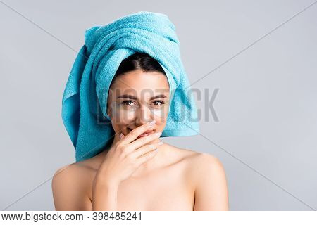 Laughing Beautiful Woman With Blue Towel On Hair And Hydrogel Eye Patches On Face Isolated On Grey