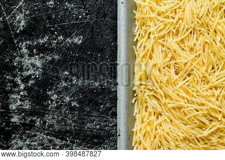 Dry Pasta Vermicelli. On Black Rustic Background