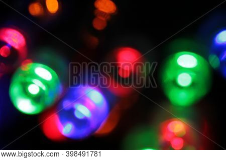 Colored lights spots of new year on a black background