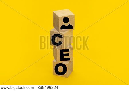 The Word Ceo Chief Executive Officer On Wooden Cubes On Yellow Background