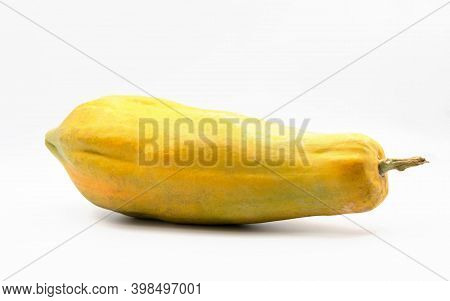 Isolated Whole Fruit Of Ripe Yellow Papaya On White Background