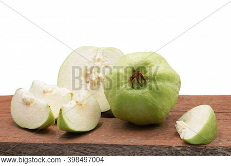 Isolated Fresh Green Guava On Wooden Board On White Background