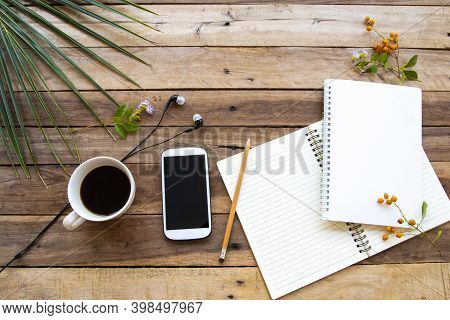 Notebook ,mobile Phone ,hot Coffee And Flowersof Lifestyle For Business Work Arrangement Flat Lay St