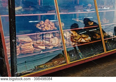 Half-empty Bakery Showcase With Leftover Bread, Pastries.  Dirty And Messy. Sri Lanka, Weligama.