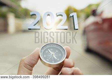 Man Hand Holding Compass On City  Blurred Background Using Wallpaper Or Background Travel For Happy
