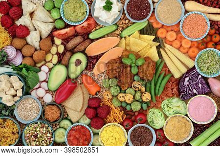 Plant based vegan food for a healthy life with vegetables, tofu, legumes, nuts, dips, grains, pasta, and snacks. High in protein, omega 3, antioxidants, vitamins, minerals, fibre for immune boost.