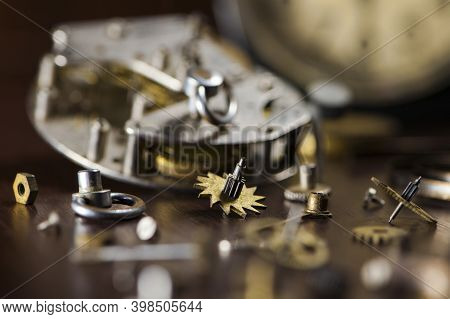 Details Close-up Parts Of A Clockwork. Clockwork Vintage Mechanical Clock, Watchmakers Table