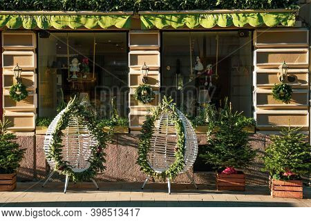 Beautiful Christmas Outdoor Ornaments And Decorations With Old Lanterns, Crowns, Chairs And Christma