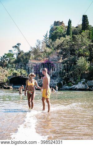 Isola Bella Small Island Near Taormina, Sicily, Italy. Narrow Path Connects Island To Mainland Taorm