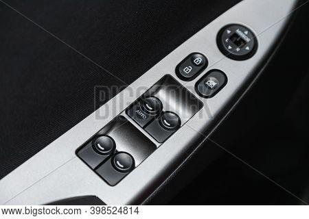 Novosibirsk, Russia - December 07, 2020:  Hyundai Solaris, Interior Of Modern Car. Side Door Buttons