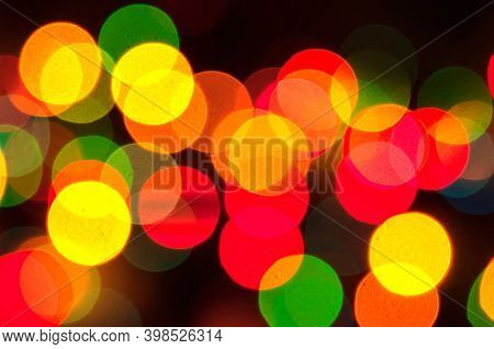 Christmas festive background. Blurred abstract Christmas background, festive Christmas multicolor bokeh background, Christmas lights, colourful Christmas bokeh background