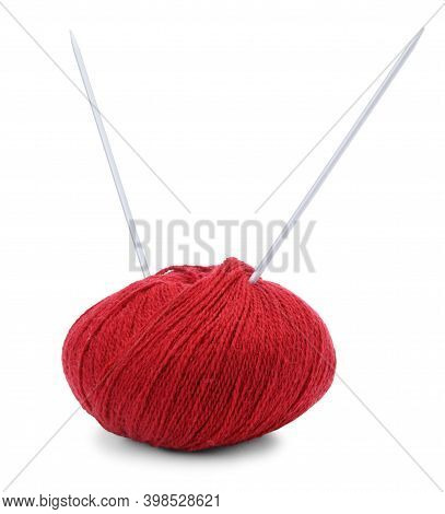 Hank Of Red Yarn And Knitting Needles Isolated On White Background.