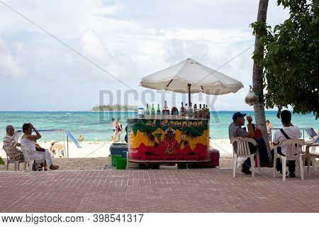 San Andres Island, Colombia - South America - November 25, 2011: People At A Beach Stand Selling Dri