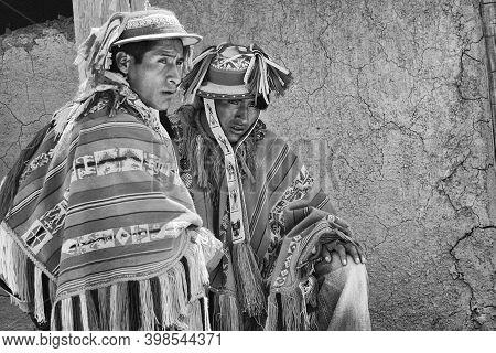 Patachancha, Cuzco, Peru - October 21, 2012: Close Up Of Two Indigenous Peruvian Men Dressed In Trad