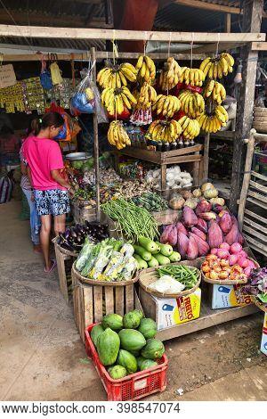 El Nido, Philippines - December 2, 2017: Vendors At A Local Food Market Place In El Nido, Philippine