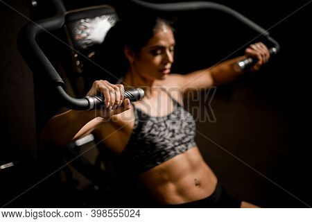 Close-up Of Woman Doing Exercises On Simulator. Concept Of Sports, Gyms, Sportswear, Fitness.
