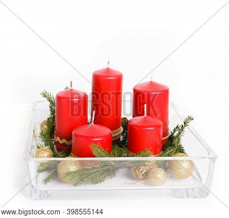 Still Life With Red Candles, Golden Balls And Ribbons, Fir Branches In Glassware On A White Backgrou