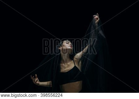 Night. Graceful Classic Female Ballet Dancer Isolated On Black Studio Background. Woman In Minimalis
