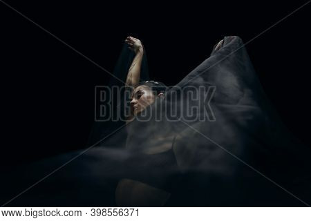 Falling. Graceful Classic Female Ballet Dancer Isolated On Black Studio Background. Woman In Minimal